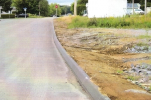 Renchaussement de bordures d'asphalte, béton et de granite